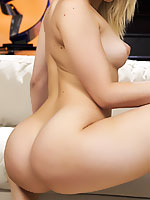Alexis Texas posing her bubble butt on the couch